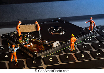 Data recovery work. - Group of worker working on computer...