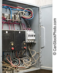 Electric panel with various wires, pawls, switches - There...