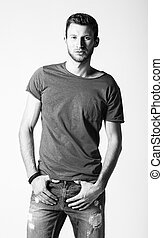 Studio fashion shot: portrait of handsome young man wearing...
