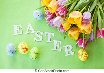 Easter background with tulips and colorful easter eggs