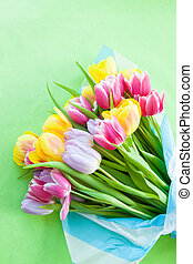 Easter background with a tulip bouquet on green