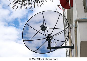 Satellite dish. - Satellite dish on the roof of the house.