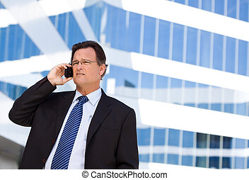 Concerned Businessman Talks on His Cell Phone - Concerned,...