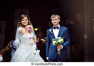 elegant gorgeous happy  brunette bride and groom standing on the background of a old church