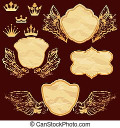Set of vintage labels in shield shapes with old paper grunge texture, golden wings and crown.