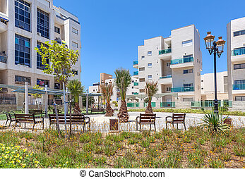 Residential buildings and small square in Ashqelon, Israel.