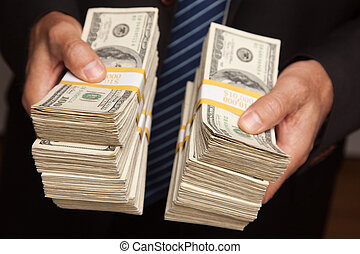 Businessman Handing Over Stacks of Money - Businessman...