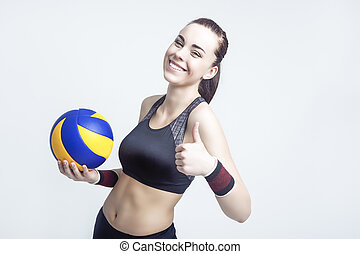 Sport Concepts and Ideas. Professional Female Volleyball Athlete With Ball Showing Thumbs Up Sign. Against White Background.