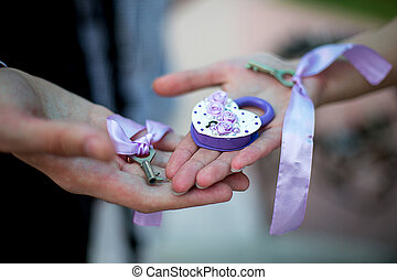 the wedding lock and key in hands - the wedding lock...