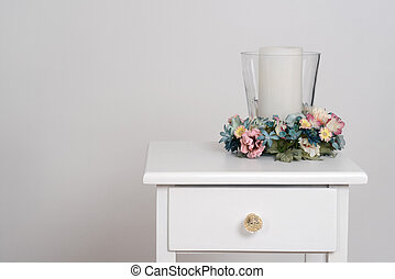 spring flowers with candle on white table