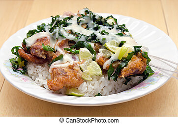 Fried chicken with lemon sauce and herb over rice (famous...