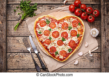 Heart shaped pizza margherita vegetarian love concept with...