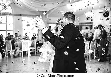 gorgeous stylish happy bride and groom performing their...