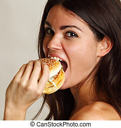 woman eat burger isolated on white background