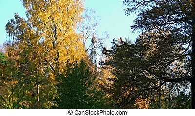 Autumn landscape with church - belfry of the trees in autumn...