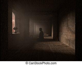 Pray in dark corridor - Devotee prays in a dimly lit...