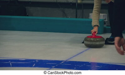 The player rolls a curling stone