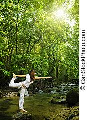 Balancing - Female practises balancing at nature tropical...