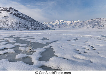 Frozen Lake with mountain backgroun - Deer Creek Reservoir...