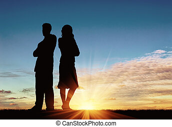 Silhouette of man and woman in a quarrel - Concept of...