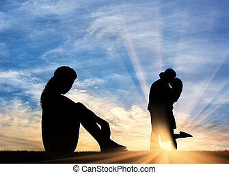 Silhouette lonely woman looking at loving couple - Concept...