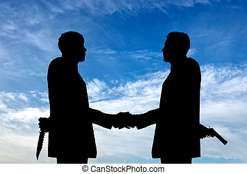 Silhouette of two businessmen shaking hands - Concept of...