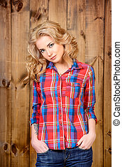 every day look - Pretty blonde girl in checkered shirt and...