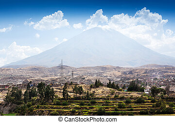 dormant volcano and the city - a dormant volcano and the...