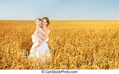 happy family in summer nature. Mother and baby daughter in...