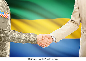 USA military man in uniform and civil man in suit shaking...