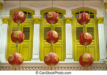 Windows and lanterns - Yellow windows and red lanterns in...