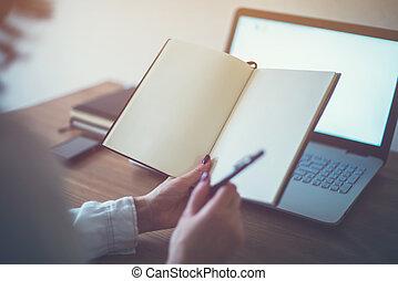 Woman freelancer working at home telework taking notes -...