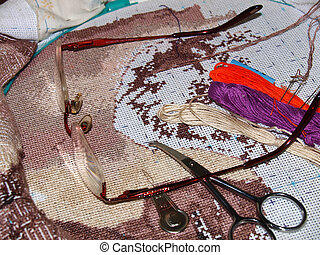 cross stitching - embroidery,on white cloth with colored...