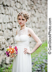 Smiling bride with bouquet