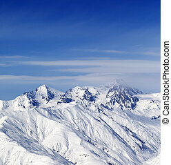 Sunny slopes of winter mountains Caucasus Mountains,...