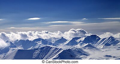 Panoramic view on cloudy mountains in evening Caucasus...