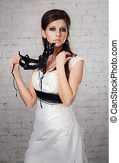 girl in a white dress with a black mask in studio