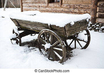 Old wooden cart in the courtyard peasant Estonian villages...