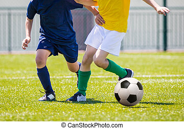 Young Boys Playing Soccer Football Match - young boys...