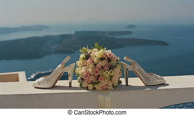Beautiful wedding shoes shot near a lake.