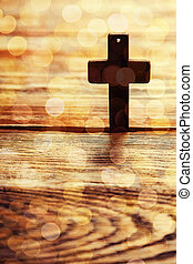 Old cross on a brown wood background