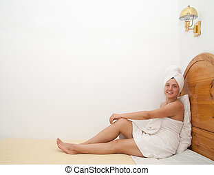 woman on her bed