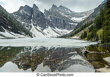 mountains reflections in Agnes Lake - Big Beehive mountain...