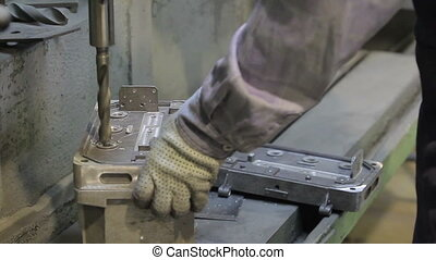 Man Drilling Holes - Man drilling with a machine making a...