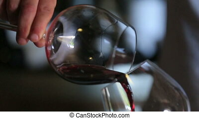 Sommelier Pouring Wine From Glass to Glass.