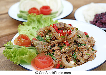 sliced grilled pork spicy salad with sticky rice and...