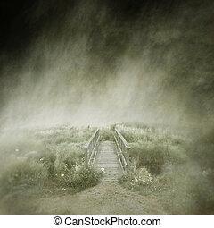 Deserted Footbridge - Deserted old wooden footbridge in a...