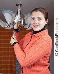 Girl changes innovation bulb