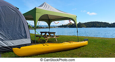 Kayak and tent in Sandspit beach New Zealand - Kayak and...