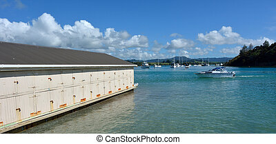 Ladscape view of an old boat shed in Sandspit New Zealand -...
